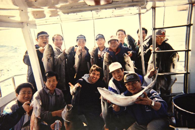 "This 2002 photo provided by Cubby's BBQ owner Bobby Egan shows Egan, center, with a group of North Koreans displaying their catches during a fishing trip with off Long Island, N.Y Egan had a well-documented, decades-long friendship with North Korean diplomats posted to the United Nations in New York. His book about his experiences dealing with the North Koreans, called ""Eating with the Enemy,"" was optioned by HBO, and actor James Gandolfini was set to portray Egan in the film before his untimely death last month. (AP Photo/Courtesy Bobby Egan)"