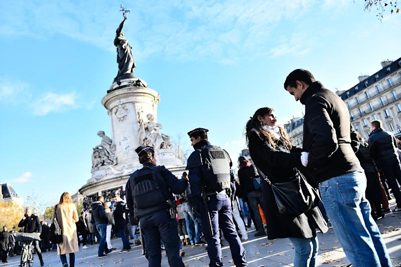 French police officers stand guard at Place de la Republique in Paris on November 22, 2015