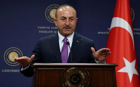 FILE PHOTO: Turkish Foreign Minister Mevlut Cavusoglu attends a press conference in Ankara