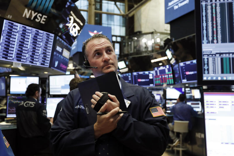 Trader Jonathan Corpina works on the floor of the New York Stock Exchange, Wednesday, June 19, 2019. Investors are in wait-and-see mode hours ahead of a widely anticipated Federal Reserve decision on interest rates. (AP Photo/Richard Drew)