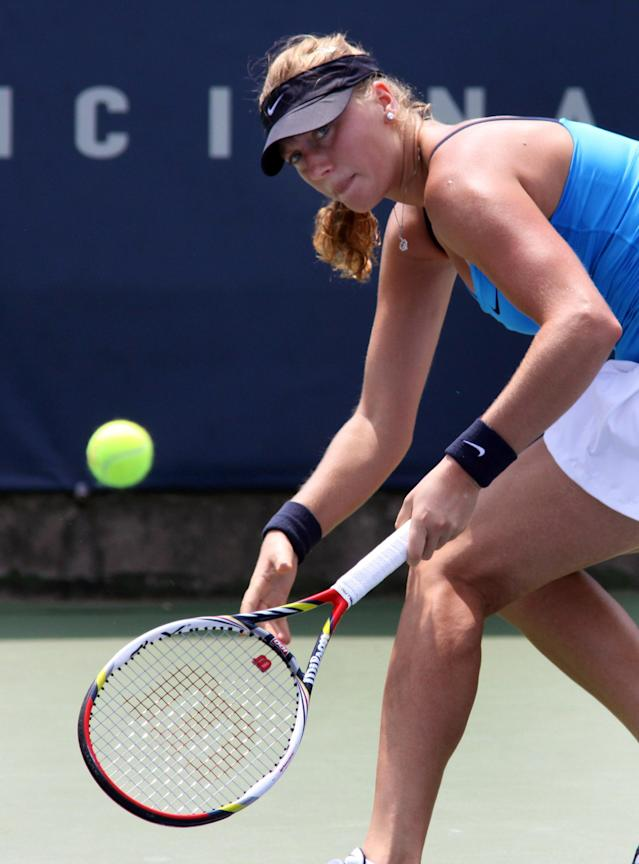 Petra Kvitova, of the Czech Republic, returns a volley to Shuai Peng, of China, during a match at the Western & Southern Open tennis tournament, Thursday Aug. 16, 2012, in Mason, Ohio. (AP Photo/Tom Uhlman)