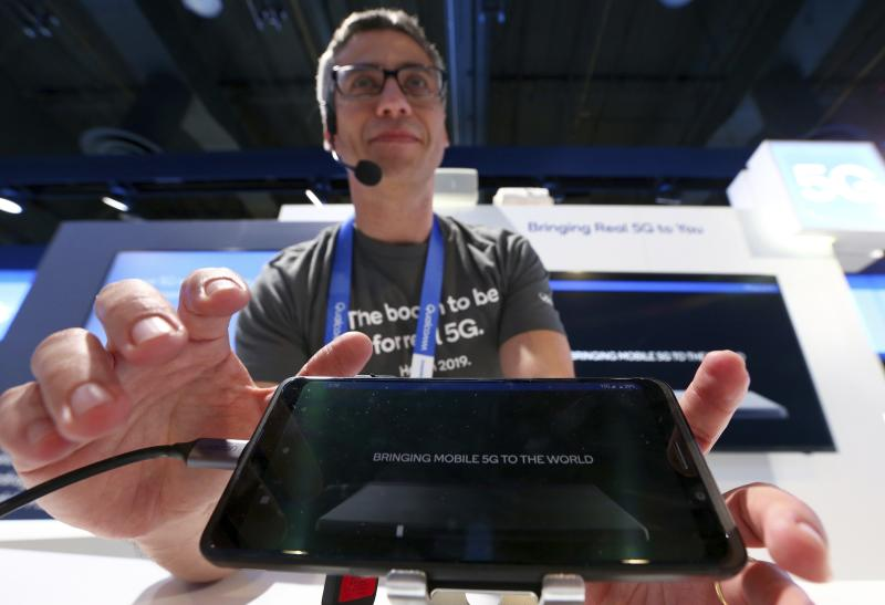 "FILE- In this Jan. 9, 2019, file photo Ignacio Contreras, of Qualcomm Technologies, talks about the new Qualcomm 5G platform network at CES International in Las Vegas. 5G is a new technical standard for wireless networks that promises faster speeds; less lag, or ""latency,"" when connecting to the network; and the ability to connect many devices to the internet without bogging it down. (AP Photo/Ross D. Franklin, File)"