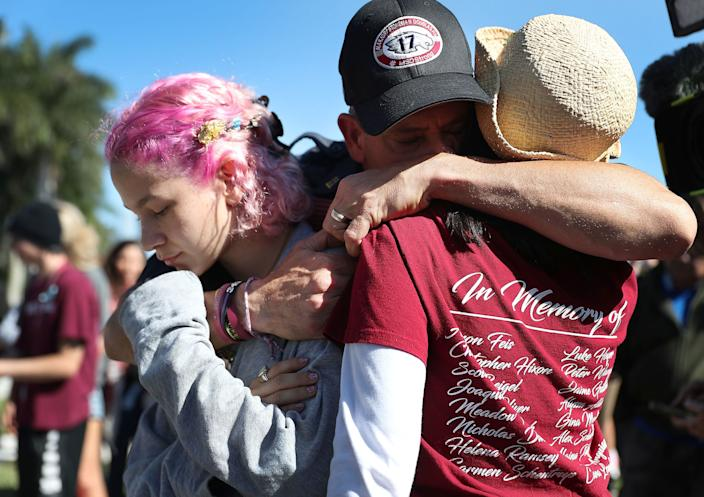 Anthony Gonzalez, center with his daughter, Victoria Gonzalez, left, and teacher Ronit Reoven at a memorial near Marjory Stoneman Douglas High School. (Photo: Joe Raedle/Getty Images)