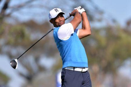 Jan 26, 2017; La Jolla, CA, USA; Tiger Woods tees off the 5th hole during the first round of the Farmers Insurance Open golf tournament at Torrey Pines Municipal Golf Course. Orlando Ramirez-USA TODAY Sports