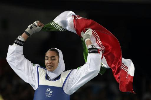 FILE - In this Aug. 18, 2016 file photo, Kimia Alizadeh Zenoorin of Iran celebrates after winning the bronze medal in a women's Taekwondo 57-kg competition at the 2016 Summer Olympics in Rio de Janeiro, Brazil. Zenoorin, Iran's only female Olympic medalist, said she defected from the Islamic Republic in a blistering online letter that describes herself as one of the millions of oppressed women in Iran. (AP Photo/Andrew Medichini, File)