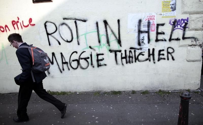 """Anti Margaret Thatcher graffiti adorns a wall on the Falls Road in west Belfast, Northern Ireland, Tuesday, April 9, 2013. The former prime minister died on Monday aged 87 after suffering a stroke while staying at the Ritz hotel in central London. Later on Monday, """"street parties"""" were held in Londonderry and west Belfast as well as other parts of Britain. (AP Photo/Peter Morrison)"""
