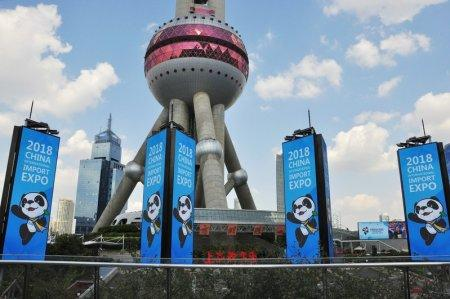 FILE PHOTO: Signs promoting the upcoming China International Import Expo (CIIE) are seen in front of the Oriental Pearl Tower at Lujiazui financial district in Pudong, Shanghai, China October 11, 2018. REUTERS/Stringer