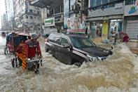 """""""More than a quarter of the country was under water,"""" said Shahjahan Mondal, a professor at the Bangladesh University of Engineering and Technology"""