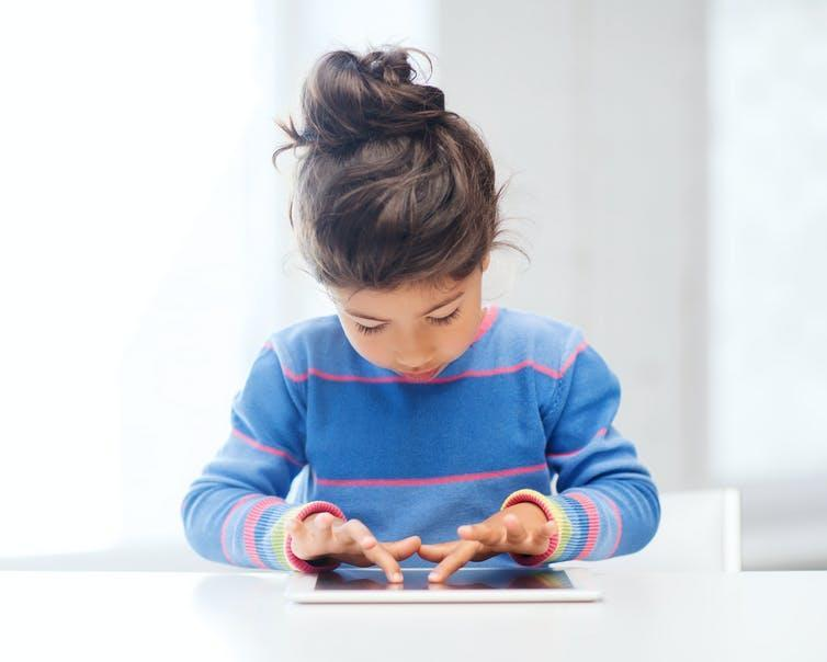 Small girl using a touchscreen tablet
