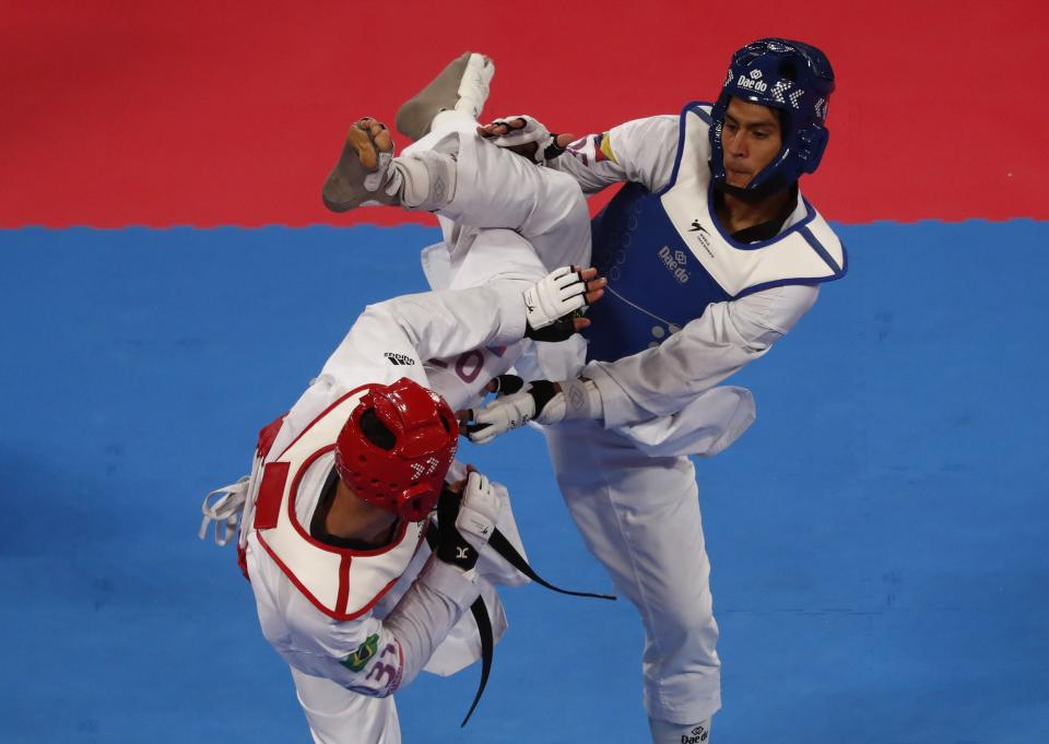 XVIII Pan American Games - Lima 2019 - Taekwondo - Men's Under 80kg Final - Callao Sports Center, Lima, Peru - July 29, 2019. Colombia's Miguel Angel Trejos in action against Icaro Martins of Brazil. REUTERS/Susana Vera