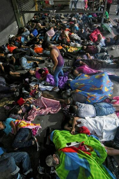 Honduran migrants sleep in the main square of Tecun Uman, Guatemala, on the border with Mexico