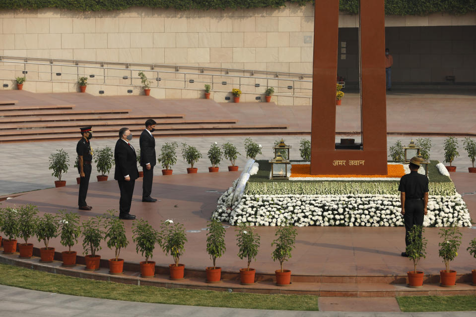 U.S. Secretary of State Mike Pompeo, foreground, and Secretary of Defence Mark Esper pay their tributes at the National War Memorial in New Delhi, India, Tuesday, Oct. 27, 2020. In talks on Tuesday with their Indian counterparts, Pompeo and Esper are to sign an agreement expanding military satellite information sharing and highlight strategic cooperation between Washington and New Delhi with an eye toward countering China. (Adnan Abidi/Pool via AP)