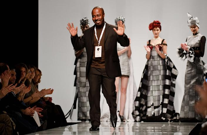 Ghanaian designer Kofi Ansah at the end of one of his shows in 2009AFP via Getty Images
