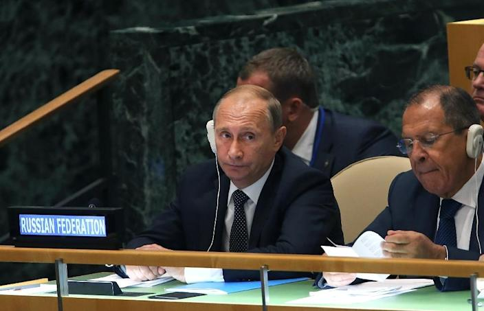 Russian President Vladimir Putin the Foreign Minister Sergey Lavrov (R), seen at the United Nations General Assembly, at the UN headquarters New York, on September 28, 2015 (AFP Photo/Spencer Platt)