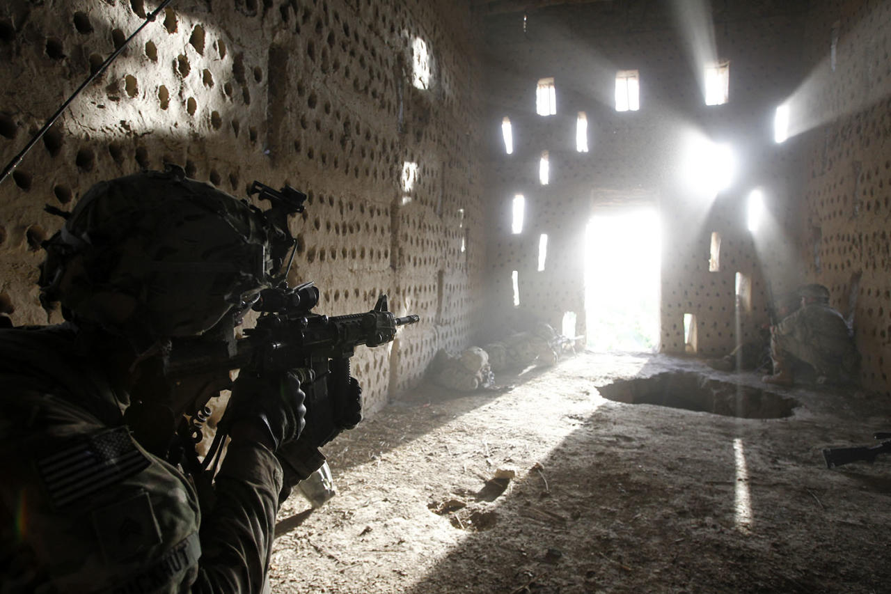 <p>U.S. soldier Nicholas Dickhut from 5-20 infantry Regiment attached to 82nd Airborne points his rifle at a doorway after coming under fire by the Taliban while on patrol in Zharay district in Kandahar province, southern Afghanistan, April 26, 2012. (Photo: Baz Ratner/Reuters) </p>