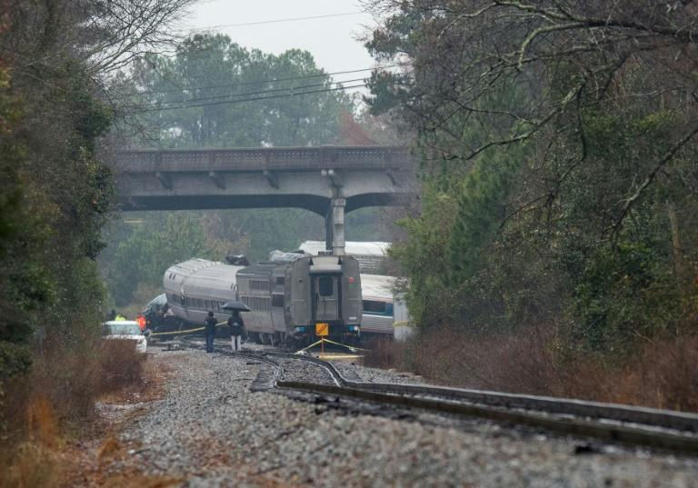 A derailed Amtrak car seen up the tracks near a crossing after an early morning collision with a CSX freight train in Cayce, South Carolina