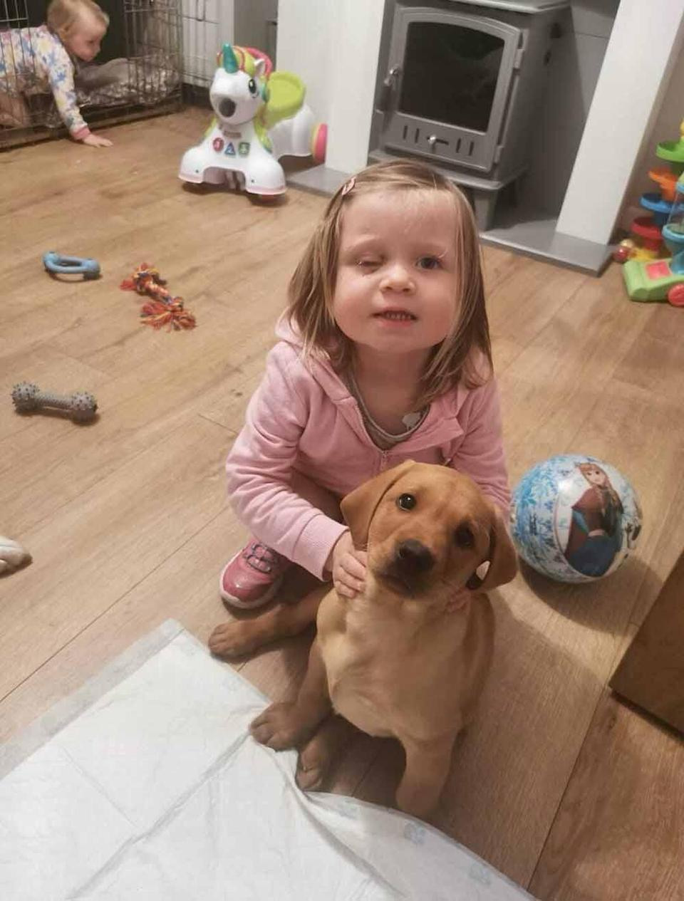 Evie with the family's puppy, Bailey. PA REAL LIFE COLLECT