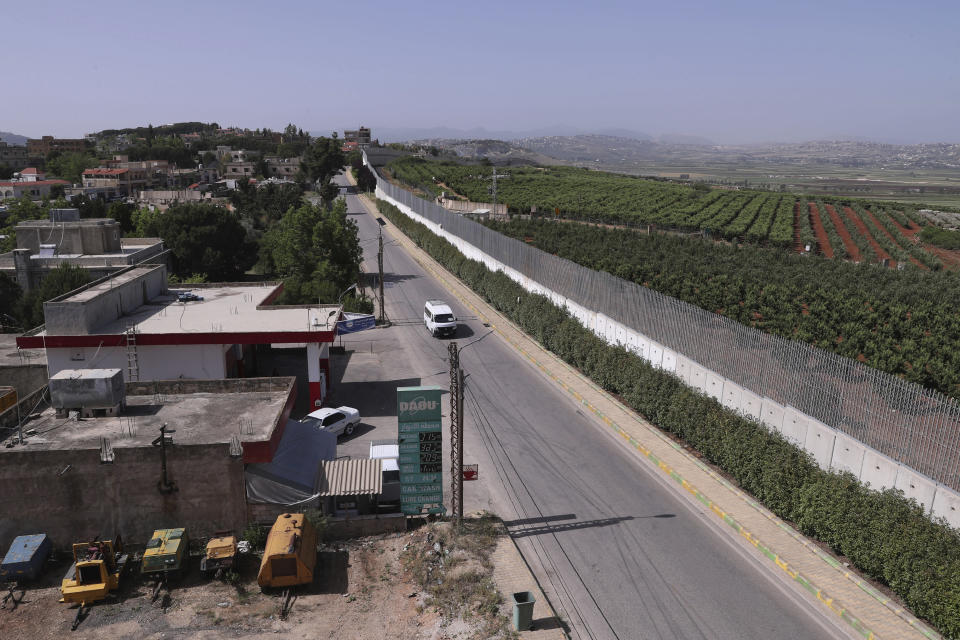 A car drives along the village of Kfar Kila on the Lebanese-Israeli border in southeast Lebanon, Wednesday, May 20, 2020. Twenty years after Hezbollah guerrillas pushed Israel's last troops from southern Lebanon, both sides are gearing up for a possible war that neither seems to want. (AP Photo/Bilal Hussein)