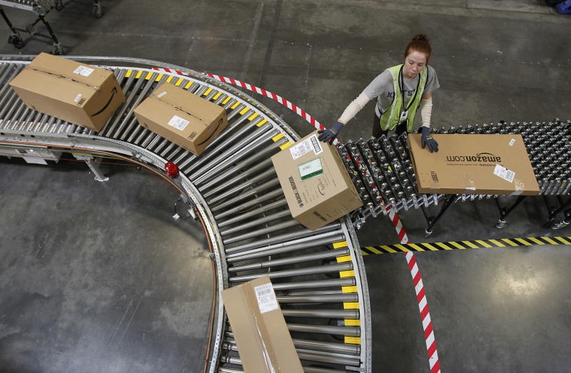 FILE - In this Nov. 11, 2010 file photo, Katherine Braun sorts packages toward the right shipping area at an Amazon.com fulfillment center in Goodyear, Ariz.  Products are flying off the shelves at Amazon warehouses across the county as Californians prepare to start paying sales taxes on online purchases. The change, which takes effect Saturday, Sept. 15, 2012, will pave the way for the e-commerce giant to open warehouses in California and offer same-day shipping to customers.  (AP Photo/Ross D. Franklin, file)