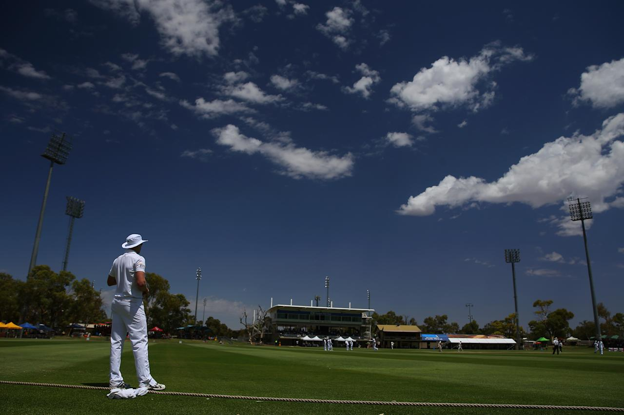 ALICE SPRINGS, AUSTRALIA - NOVEMBER 30: (EDITORS NOTE: A POLARIZING FILTER WAS USED IN THE CREATION OF THIS IMAGE)  A general view is seen as Boyd Rankin of England looks on from the outfield during day two of the tour match between the Chairman's XI and England at Traeger Park Oval on November 30, 2013 in Alice Springs, Australia.  (Photo by Mark Kolbe/Getty Images)