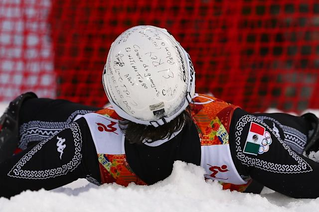 Mexico's Hubertus von Hohenlohe wears handwritten messages on his helmet as he crashes during the first run of the men's slalom at the Sochi 2014 Winter Olympics, Saturday, Feb. 22, 2014, in Krasnaya Polyana, Russia. (AP Photo/Alessandro Trovati)