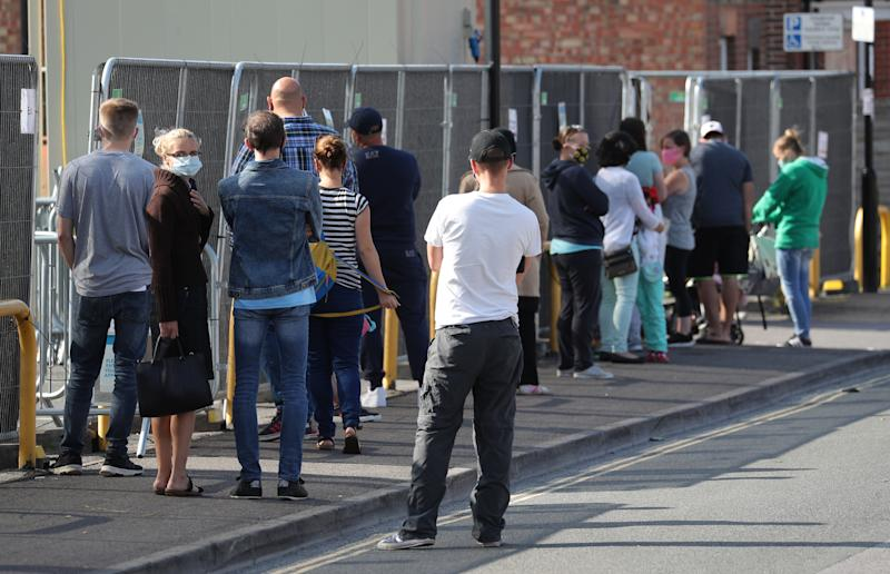 People queue up outside a walk through coronavirus testing centre on Marlborough Road in Southampton. (Photo by Andrew Matthews/PA Images via Getty Images)