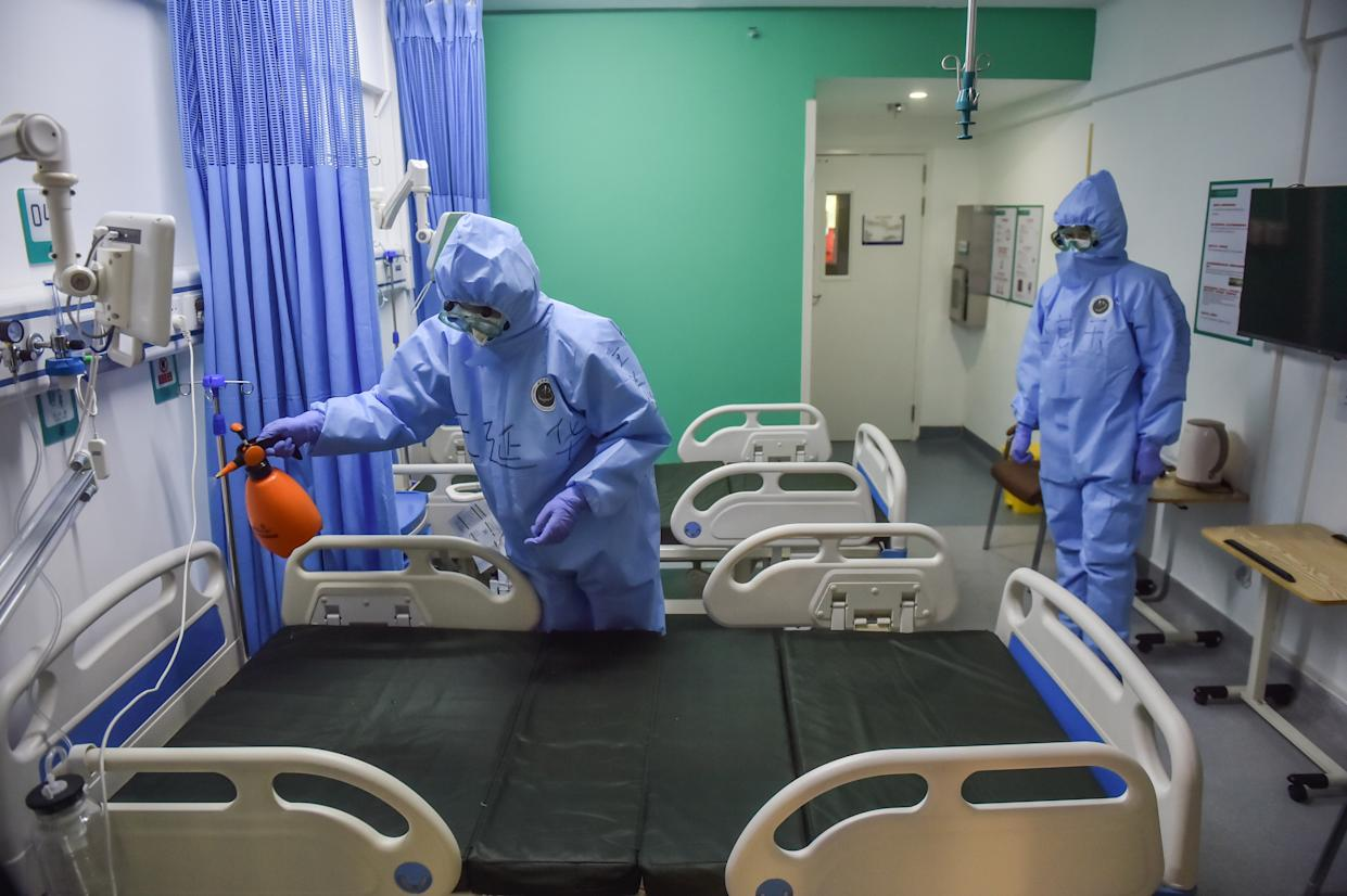 BEIJING, April 28, 2020 .Medical staff of Xiaotangshan Hospital disinfect a ward after the hospital cleared all COVID-19 cases in Beijing, capital of China, April 28, 2020.   Xiaotangshan Hospital, which was previously used to quarantine SARS patients in Beijing, cleared all COVID-19 cases Tuesday and is scheduled to cease operation Wednesday.    The hospital, located in the city's northern suburb, was renovated and put into operation on March 16 for the screening and treatment of imported mild and common confirmed COVID-19 cases, suspected cases and those who need to be tested. (Photo by Peng Ziyan/Xinhua via Getty) (Xinhua/Peng Ziyang via Getty Images)