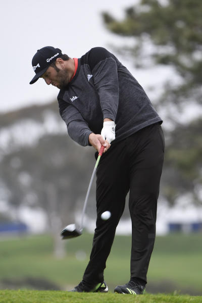 Jon Rahm, of Spain, hits his tee shot on the fifth hole of the South Course at Torrey Pines Golf Course during the final round of the Farmers Insurance golf tournament Sunday, Jan. 26, 2020, in San Diego. (AP Photo/Denis Poroy)