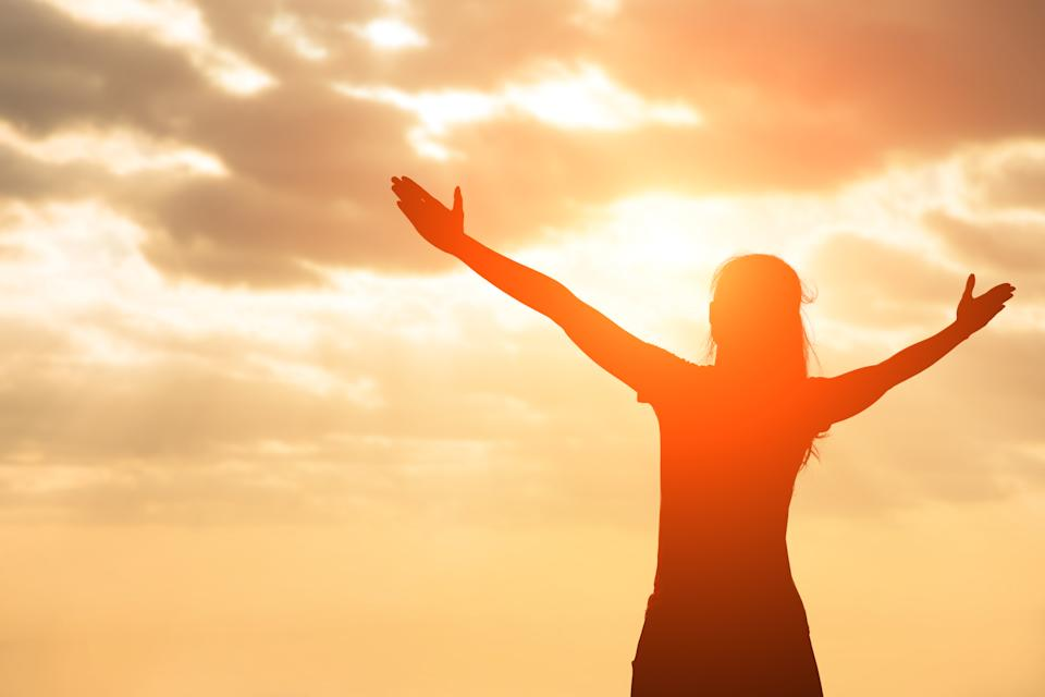 silhouette of woman pray with sunlight