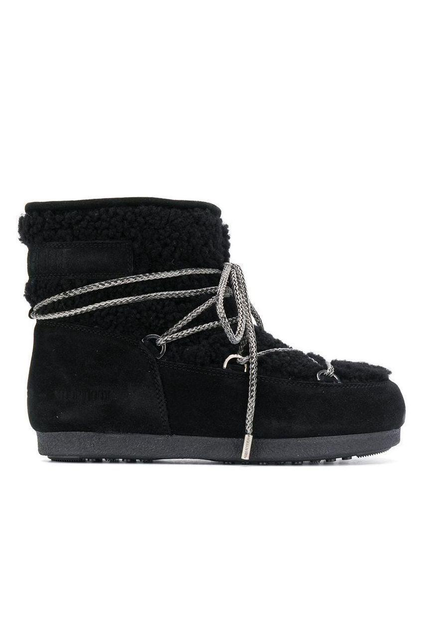 """<p><strong>Moon Boot</strong></p><p>farfetch.com</p><p><strong>$270.00</strong></p><p><a href=""""https://go.redirectingat.com?id=74968X1596630&url=https%3A%2F%2Fwww.farfetch.com%2Fshopping%2Fwomen%2Fmoon-boot-lace-up-snow-boots-item-14649300.aspx&sref=https%3A%2F%2Fwww.marieclaire.com%2Ffashion%2Fg34382850%2Fwinter-2020-shoe-trends%2F"""" rel=""""nofollow noopener"""" target=""""_blank"""" data-ylk=""""slk:SHOP IT"""" class=""""link rapid-noclick-resp"""">SHOP IT </a></p><p>The contrasting laces give this pair a sporty-feel. </p>"""