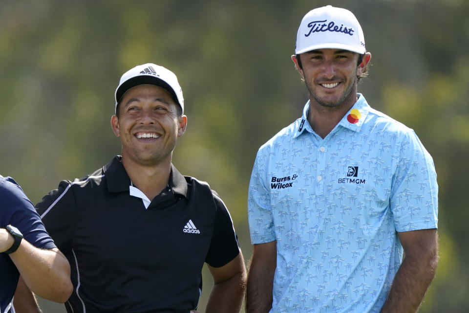 Xander Schauffele, left, and Max Homa laugh on the 12th tee during the first round of the U.S. Open Golf Championship, Thursday, June 17, 2021, at Torrey Pines Golf Course in San Diego. (AP Photo/Marcio Jose Sanchez)
