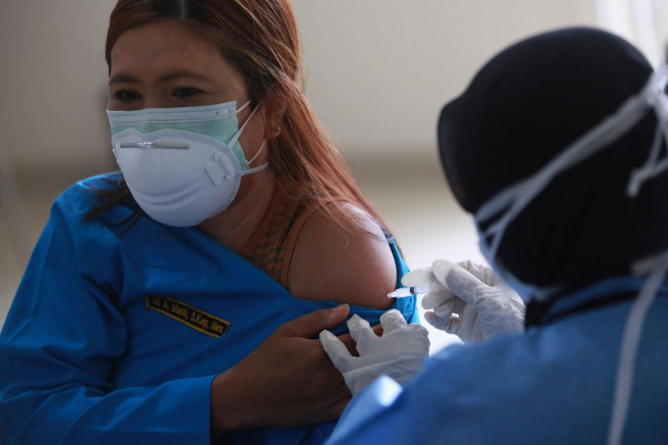 Virus Outbreak Indonesia (Copyright 2021 The Associated Press. All rights reserved.)