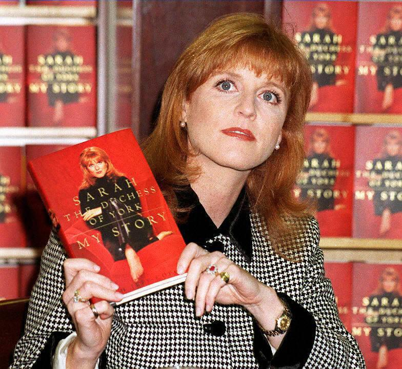 NEW YORK, NY - NOVEMBER 14:  Sarah Ferguson, the Duchess of York, holds up a copy of her autobiography 14 November at a Manhattan bookstore in New York. Ferguson is divorced from Britain's Prince Andrew.  (Photo credit should read MALCOLM CLARKE/AFP via Getty Images)