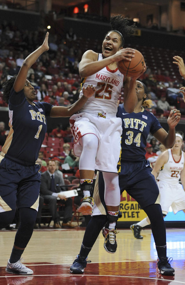Maryland forward Alyssa Thomas (25) grabs a rebound between Pittsburgh guard Loliya Briggs (1) and forward Chyna Golden (34) during the second half of an NCAA college basketball game Thursday, Feb. 6, 2014, in College Park, Md. Maryland won 94-46. (AP Photo/Gail Burton)