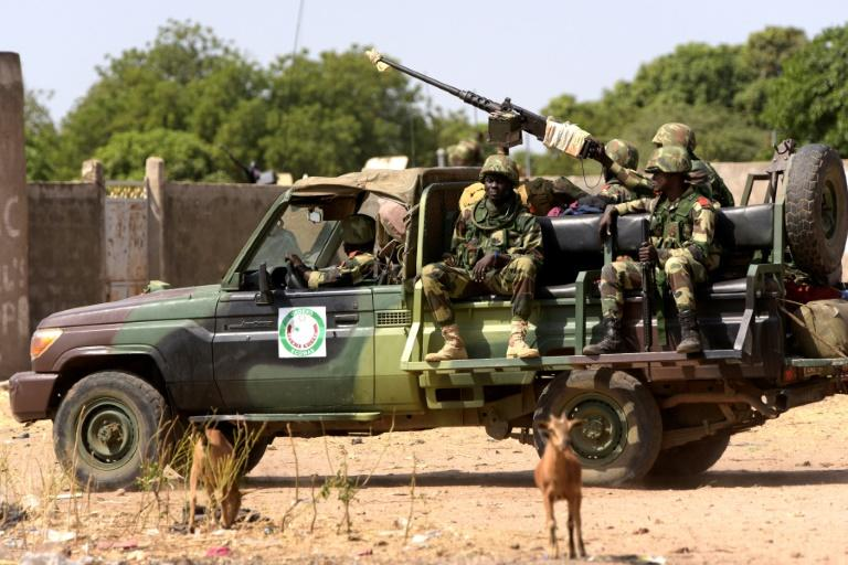 Senegalese soldiers patrol the area close to the Senegal-Gambia border near Karang on January 20, 2017