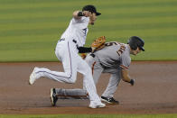 Miami Marlins third baseman Brian Anderson tags San Francisco Giants' Mike Yastrzemski (5) during the first inning of a baseball game, Sunday, April 18, 2021, in Miami. (AP Photo/Marta Lavandier)