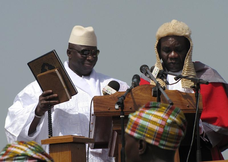 Yayah Jammeh (left) takes an oath during the swearing-in ceremony for his fourth term on January 19, 2012 in Banjul