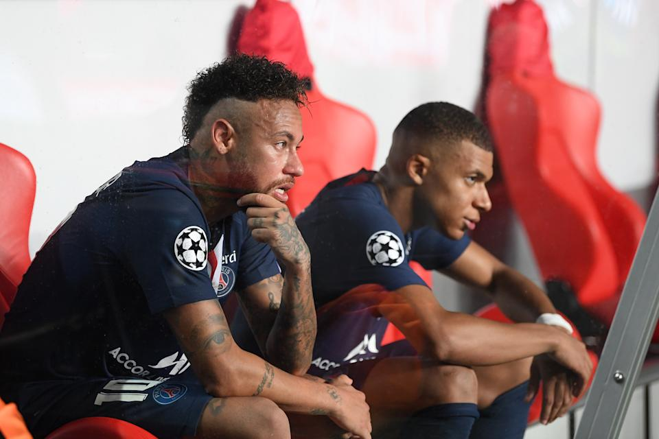 LISBON, PORTUGAL - AUGUST 23: Neymar and Kylian Mbappe of Paris Saint-Germain look dejected following their team's defeat in the UEFA Champions League Final match between Paris Saint-Germain and Bayern Munich at Estadio do Sport Lisboa e Benfica on August 23, 2020 in Lisbon, Portugal. (Photo by Michael Regan - UEFA/UEFA via Getty Images)