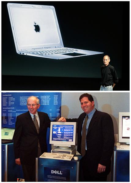 FILE -In this combination of Associated Press file photos, Apple CEO Steve Jobs, top, talks about the new Apple Macbook Air laptop at Apple headquarters in Cupertino, Calif, on Oct. 20, 2010, and bottom Michael Dell, right, CEO of Dell, stands next to one his desktop computers in New Delhi, India, on Sept. 28, 2000. Desktop computers with big CRT monitors are being replaced with laptops, tablet computers, and smart phones. It costs $1.36 to power an iPad for a year, compared with $28.21 for a desktop computer, according to the Electric Power Research Institute. (AP Photo/File)
