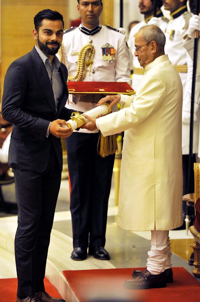 <p>Indian President Pranab Mukherjee presents the Padma Shri award to Indian cricketer Virat Kohli at the Presidential Palace in New Delhi, India, Thursday, March 30, 2017. Padma Shri is the fourth highest civilian award given to people for their distinguished contribution in various fields. (AP Photo) </p>