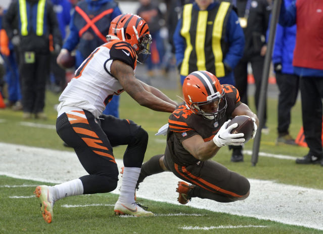 Cleveland Browns running back Nick Chubb (24) rushes against Cincinnati Bengals defensive back Darqueze Dennard (21) during the first half of an NFL football game, Sunday, Dec. 23, 2018, in Cleveland. (AP Photo/David Richard)