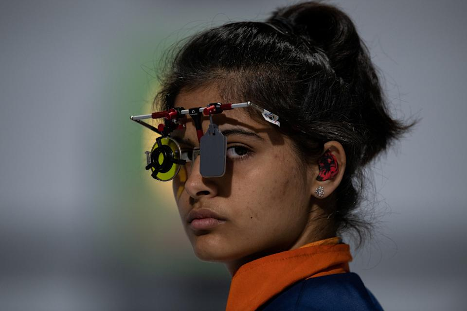 Manu Bhaker of India competes in the Shooting 10m Air Pistol Mixed International Team Quarter-final at the Shooting Range, Tecnopolis Park, Buenos Aires, Argentina, October 12, 2018. Lukas Schulze for OIS/IOC/Handout via REUTERS ATTENTION EDITORS - THIS IMAGE HAS BEEN SUPPLIED BY A THIRD PARTY.