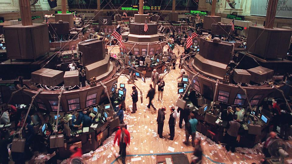 WALL STREET New York stock exchange traders walk the floor after the close of the exchange, where the Dow Jones industrial average surged 55.