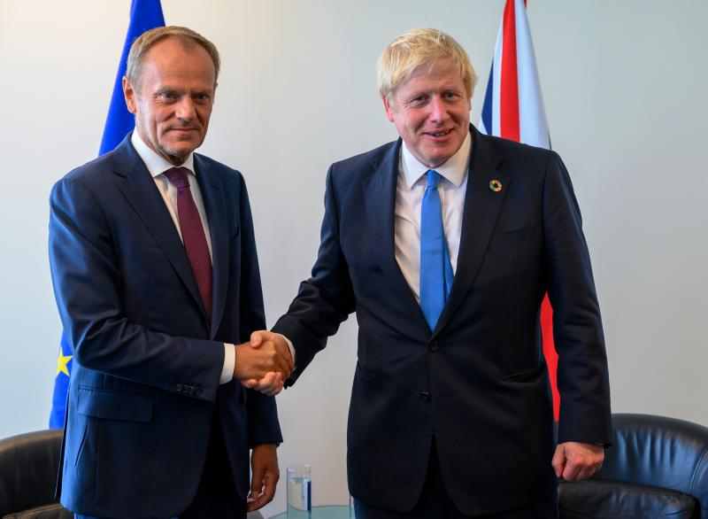 Donald Tusk (L), President of the European Council, and Boris Johnson, Prime Minister of the United Kingdom, meet at the United Nations September 23, 2019, in New York. (Photo by Don Emmert / AFP) (Photo credit should read DON EMMERT/AFP/Getty Images)