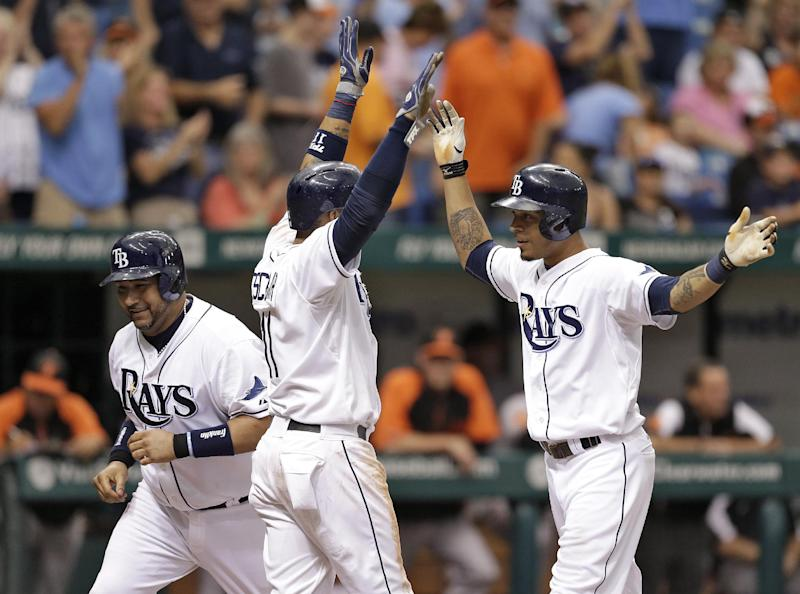 Tampa Bay Rays' Desmond Jennings, right, celebrates with teammate Jose Molina, left, and Yunel Escobar, center, after hitting a three run home run off Baltimore Orioles starting pitcher Miguel Gonzalez during the fifth inning of a baseball game Saturday, Sept. 21, 2013, in St. Petersburg, Fla. (AP Photo/Chris O'Meara)