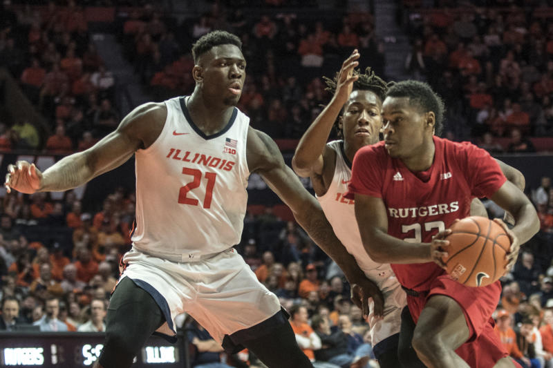 Rutgers' Montez Mathis (23) drives to the basket as Illinois' Kofi Cockburn (21) and Ayo Dosunmu (11) defend in the second half of an NCAA college basketball game, Sunday, Jan. 11, 2020, in Champaign, Ill. (AP Photo/Holly Hart)