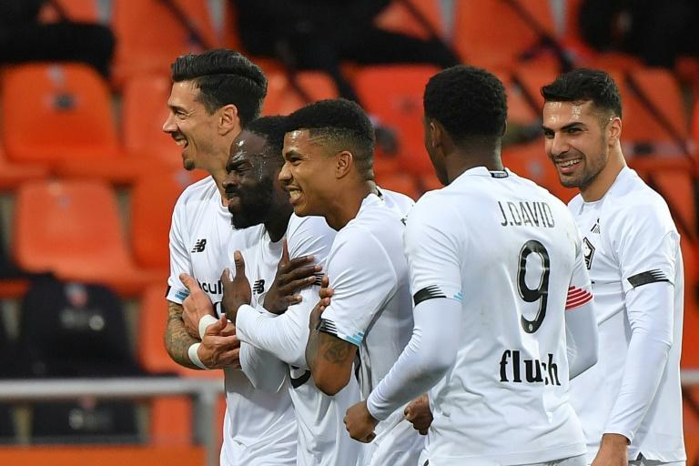 Jonathan Ikone (2ndL) celebrates with his teammates after scoring Lille's third goal in their win at Lorient on Sunday
