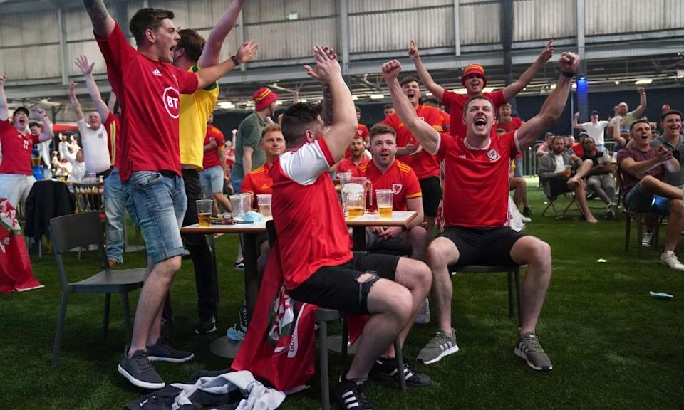 Wales fans enjoy the moment at a fanzone in Cardiff where many will gather again for Wednesday night's crucial Group A game against Turkey.