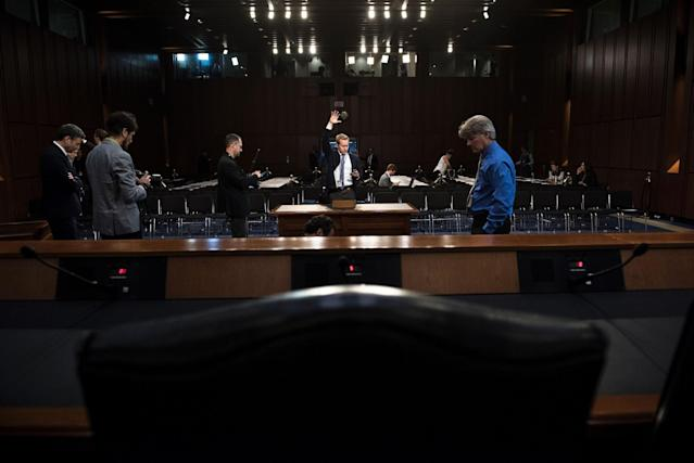 <p>People make preparations for a hearing before the Senate Select Committee on Intelligence with ousted FBI director James Comey on Capitol Hill June 8, 2017 in Washington. (Photo: Brendan Smialowski /AFP/Getty Images) </p>
