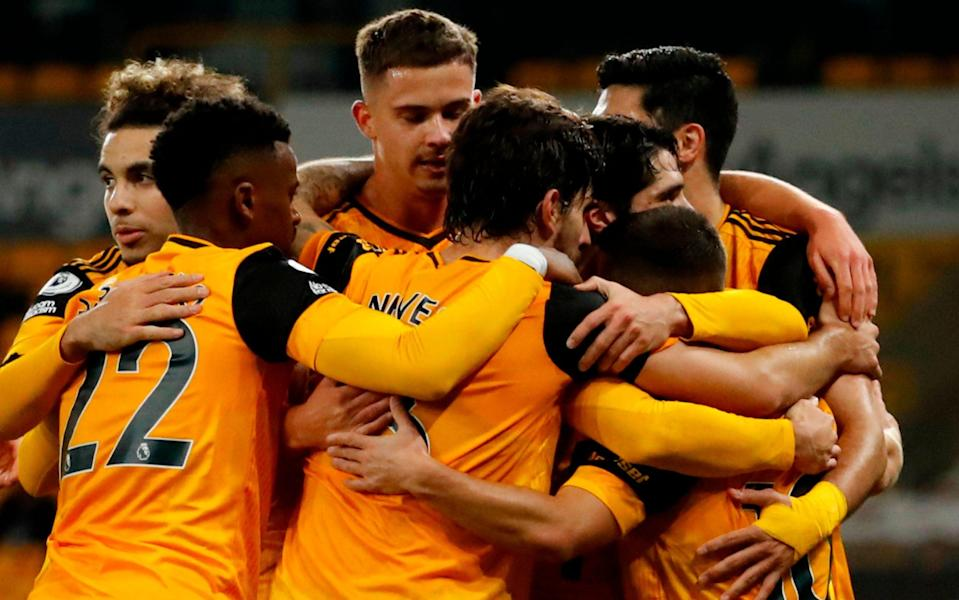 Wolverhampton Wanderers' Portuguese midfielder Daniel Podence (R) celebrates with team-mates after scoring their second goal during the English Premier League football match between Wolverhampton Wanderers and Crystal Palace at the Molineux stadium in Wolverhampton, central England on October 30, 2020. - AFP
